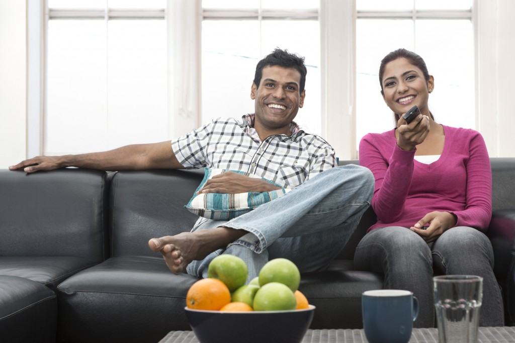Happy Indian couple on the sofa